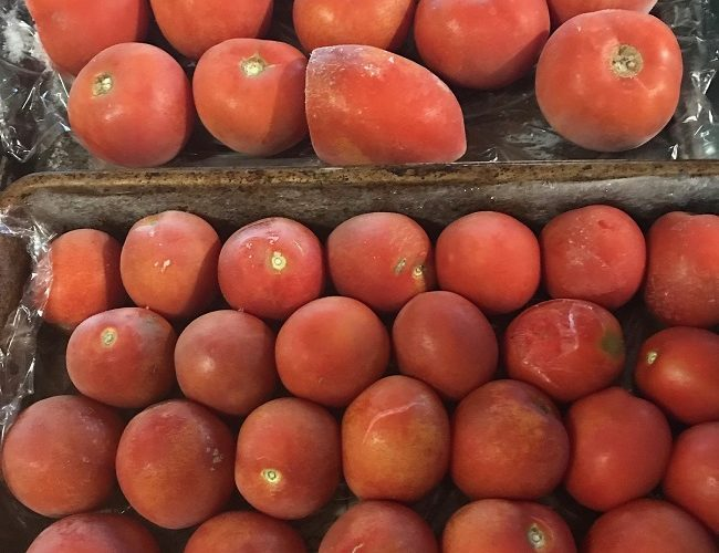 Freeze whole tomatoes to store them