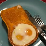 Eggs in honeynut squash